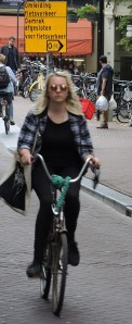 Blonde on Bicycle! So typical of Amsterdam and its people